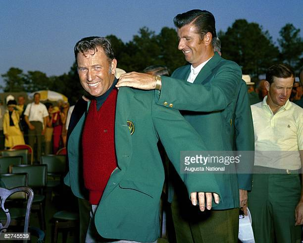 George Archer presents the Green Jacket to Billy Casper during the Presentation Ceremony during the April 1970 Masters Tournament at Augusta National...
