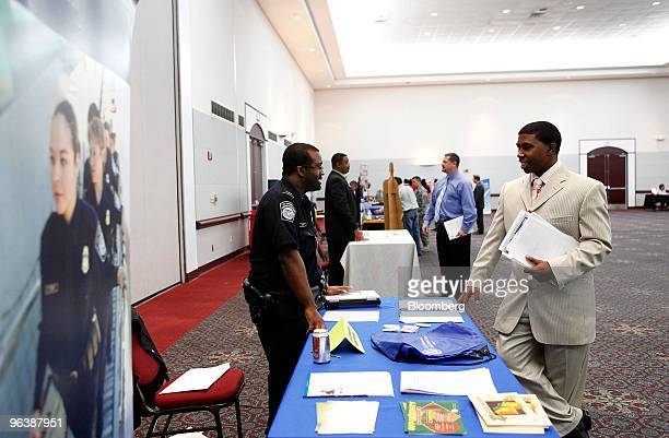 George Armstrong right speaks to a recruiter from the US Customs and Border Protection agency at the Houston Diversity Job Fair in Humble Texas US on...