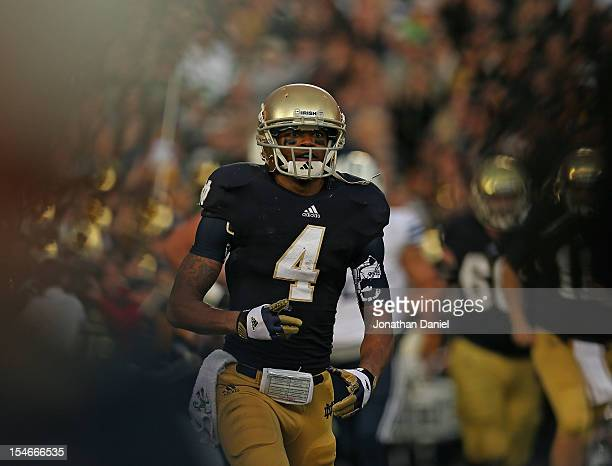 George Atiknson III of the Notre Dame Fighting Irish runs back to the bench after catching a touchdown pass against the BYU Cougars at Notre Dame...