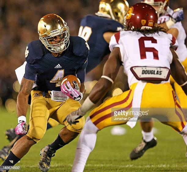 George Atkinson III of the Notre Dame Fighting Irish moves against Josh Shaw of the University of Southern California Trojans at Notre Dame Stadium...