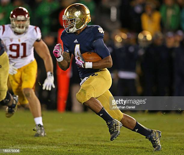George Atkinson III of the Notre Dame Fighting Irish runs against the University of Southern California Trojans at Notre Dame Stadium on October 19...