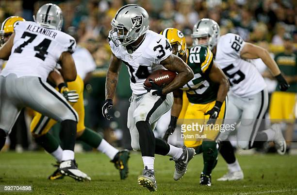 George Atkinson III of the Oakland Raiders runs with the ball in the fourth quarter of a preseason game against the Green Bay Packers at Lambeau...