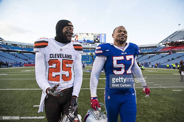 George Atkinson of the Cleveland Browns and Lorenzo Alexander of the Buffalo Bills talk as they exit the field after the game on December 18 2016 at...