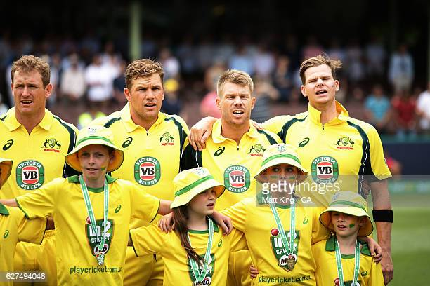 George Bailey Aaron Finch David Warner and Steve Smith of Australia sing their national anthem during game one of the One Day International series...