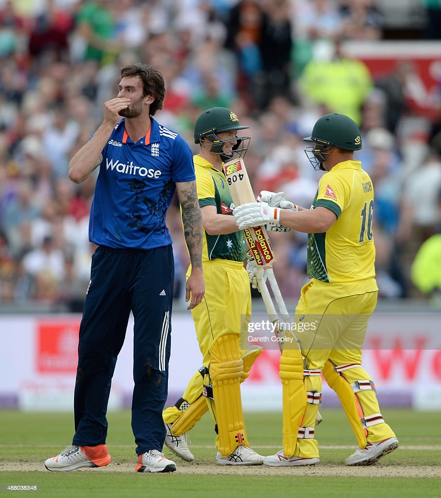George Bailey and Aaron Finch of Australia celebrate as Reece Topley of England reacts after winning the 5th Royal London One-Day International match between England and Australia at Old Trafford on September 13, 2015 in Manchester, United Kingdom.