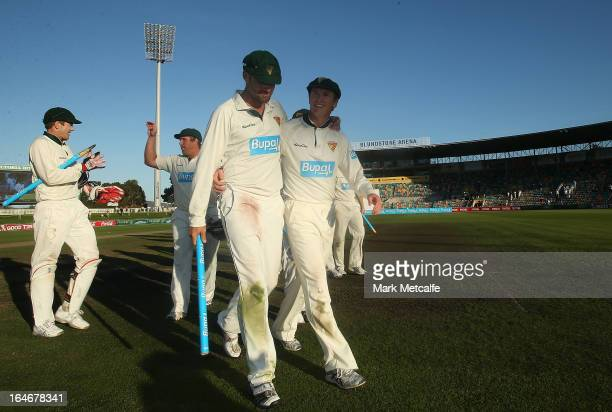 George Bailey and Alex Doolan of the Tigers celebrate victory in the Sheffield Shield final between the Tasmania Tigers and the Queensland Bulls at...