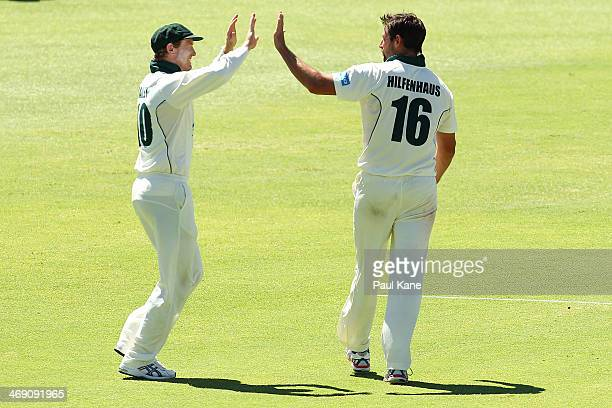 George Bailey and Ben Hilfenhaus of the Tigers celebrate the dismissal of Marcus North of the Warriors during day two of the Sheffield Shield match...