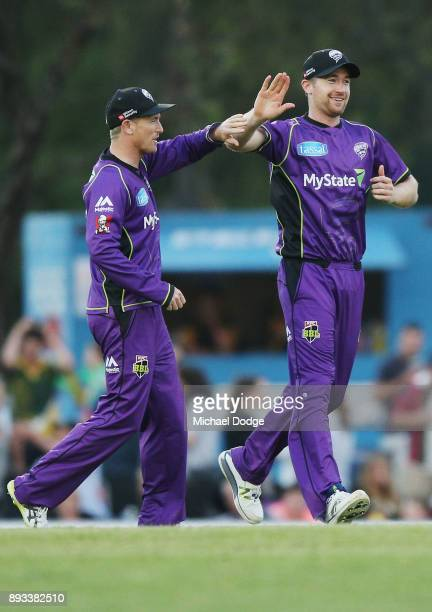 George Bailey and D'Arcy Short of the Hurricanes celebrate a wicket during the Twenty20 BBL practice match between the Melbourne Stars and the Hobart...