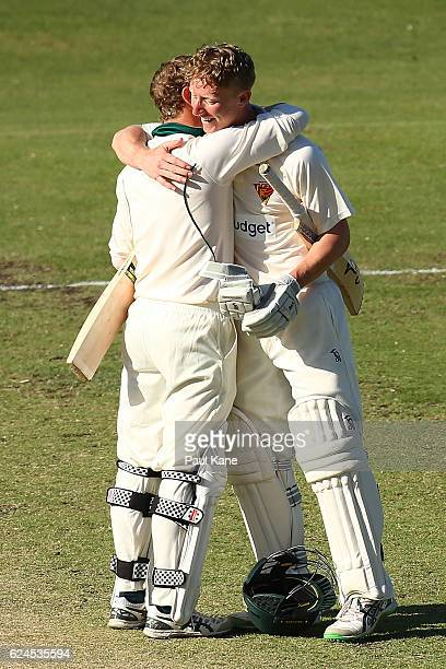 George Bailey and Jordan Silk of Tasmania celebrate after winning on day four of the Sheffield Shield match between Western Australia and Tasmania at...