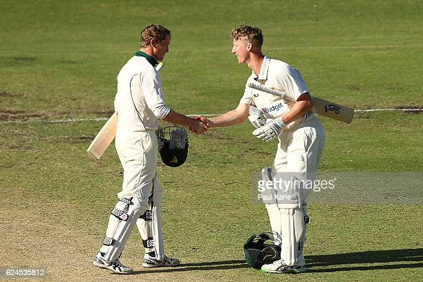 George Bailey and Jordan Silk of Tasmania shake hands after winning on day four of the Sheffield Shield match between Western Australia and Tasmania...
