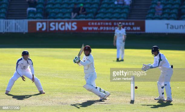 George Bailey and Lewis McManus of Hampshire look on as Steve Davies of Somerset scores runs during Day One of The Specsavers County Championship...