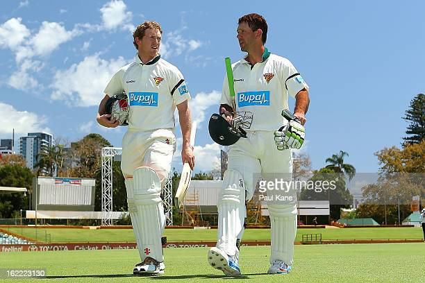 George Bailey and Ricky Ponting of the Tigers wlak from the field at the lunch break during day one of Sheffield Shield match between the Western...