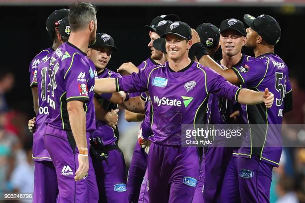 George Bailey and the Hurricanes celebrates winning the Big Bash League match between the Brisbane Heat and the Hobart Hurricanes at The Gabba on...