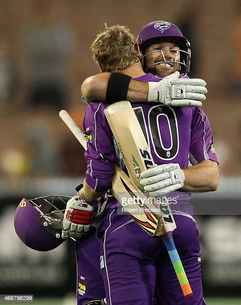 George Bailey and Travis Birt of the Hurricanes celebrate winning the Big Bash League Semi Final match between the Melbourne Stars and the Hobart...
