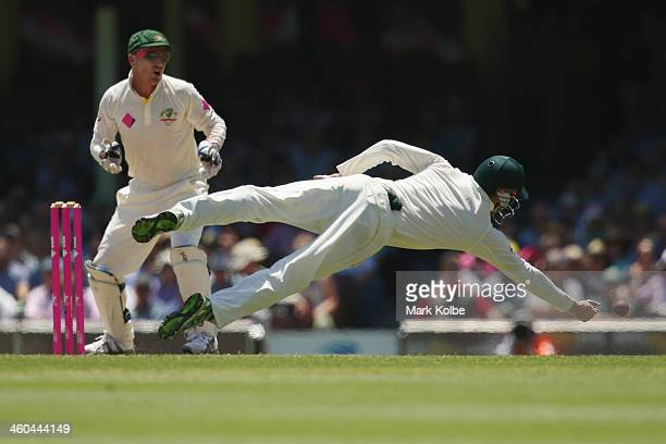 George Bailey of Australia dives to try and take a catch during day two of the Fifth Ashes Test match between Australia and England at Sydney Cricket...