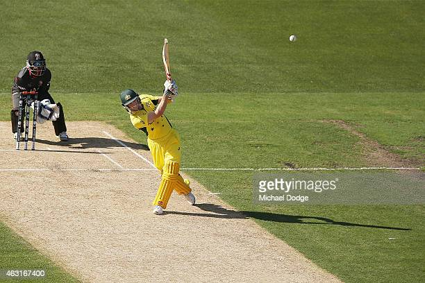 George Bailey of Australia hits a six during the Cricket World Cup warm up match between Australia and the United Arab Emirates at Melbourne Cricket...