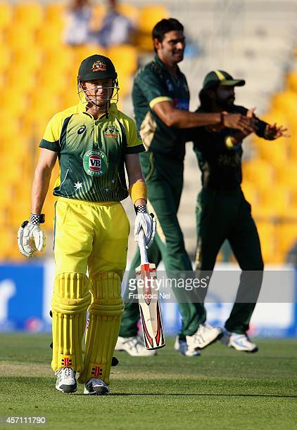 George Bailey of Australia leaves the field after being dismissed by Muhammad Irfan of Pakistan during the third match of the one day international...