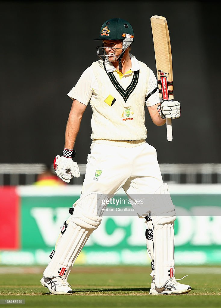 George Bailey of Australia raises his bat after scoring his half century during day one of the Second Ashes Test Match between Australia and England at Adelaide Oval on December 5, 2013 in Adelaide, Australia.
