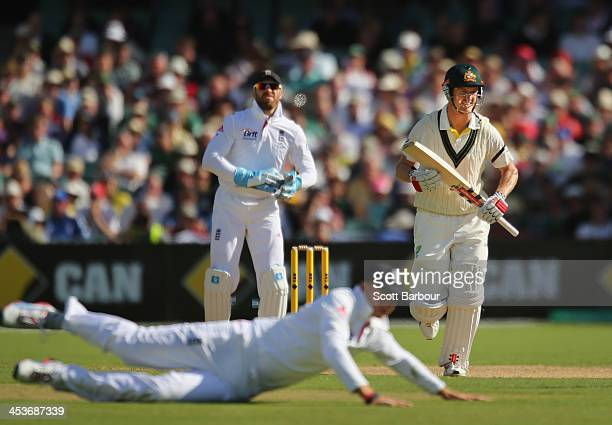 George Bailey of Australia runs between the wickets as Joe Root of England dives for the ball during day one of the Second Ashes Test Match between...