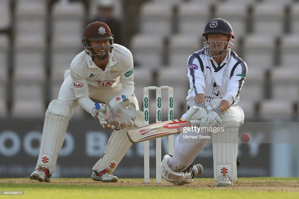 George Bailey of Hampshire attempts a reverse sweep off the bowling of Gareth Batty as Surrey wicketkeeper Ben Foakes looks on during day two of the Specsavers County Championship Division One match between Hampshire and Surrey at the Ageas Bowl on September 6, 2017 in Southampton, England.