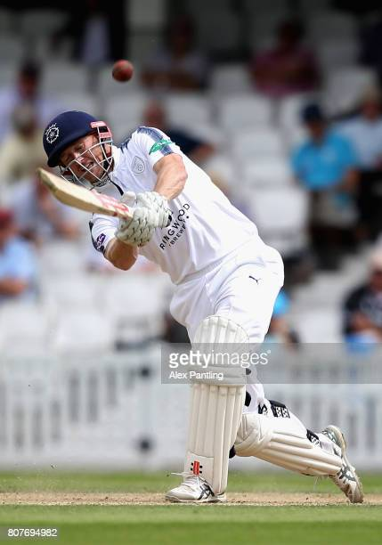 George Bailey of Hampshire hits a six to make his score 150 during day two of the Specsavers County Championship Division One match between Surrey...