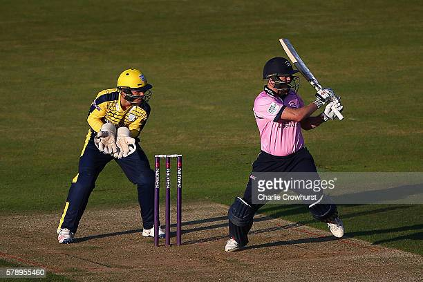 George Bailey of Middlesex hits out while Hampshire wicket keeper Lewis McManus looks on during the NatWest T20 Blast match between Hampshire and...