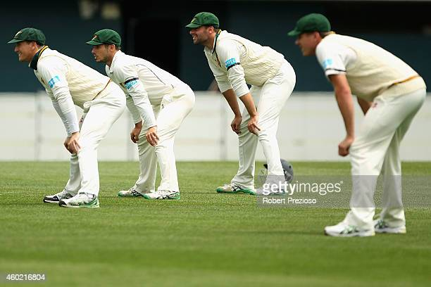 George Bailey of Tasmania fields with teammates during day two of the Sheffield Shield match between Tasmania and South Australia at Blundstone Arena...