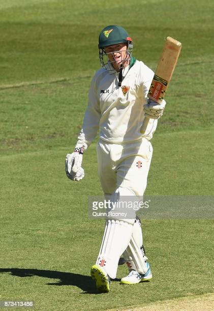 George Bailey of Tasmania raises his bat after making 100 during day one of the Sheffield Shield match between Victoria and Tasmania at Melbourne...