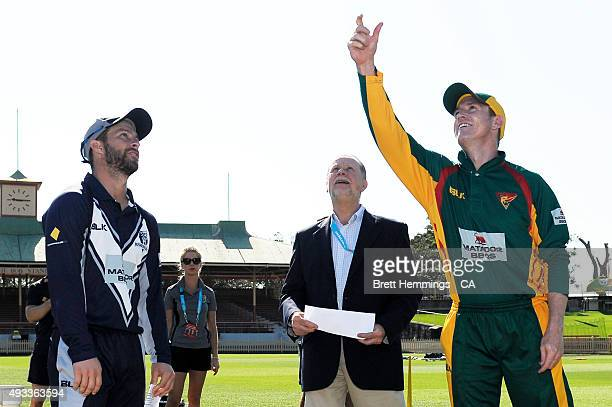 George Bailey of Tasmania tosses the coin with Matthew Wade of Victoria prior to the Matador BBQs One Day Cup match between Tasmania and Victoria at...