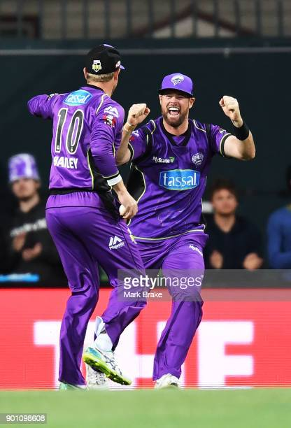 George Bailey of the Hobart Hurricanes celebrates after taking the wicket of Jake Weatherald of the Adelaide Strikers with Dan Christian of the...