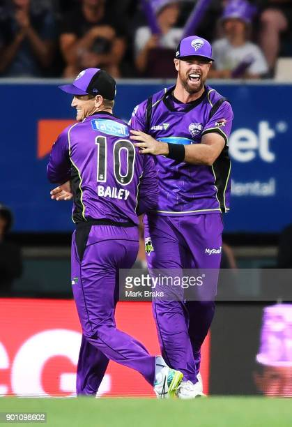 George Bailey of the Hobart Hurricanes celebrates catching the wicket of Jake Weatherald of the Adelaide Strikers with Dan Christian of the Hobart...