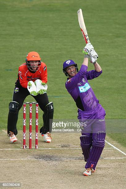 George Bailey of the Hobart Hurricanes plays a shot to get out in front on Sam Whiteman of the Perth Scorchers during the Big Bash League match...