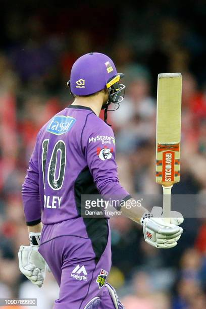George Bailey of the Hobart Hurricanes raises his bat after scoring 50 runs during the Big Bash League match between the Melbourne Renegades and the...