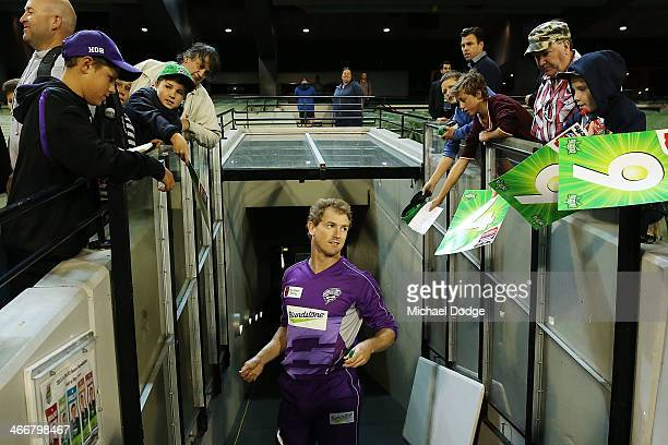 George Bailey of the Hurricanes autographs for fans during the Big Bash League Semi Final match between the Melbourne Stars and the Hobart Hurricanes...