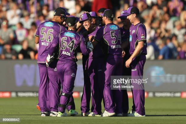 George Bailey of the Hurricanes celebrates after taking a catch to dismiss Kurtis Patterson of the Thunder during the Big Bash League match between...