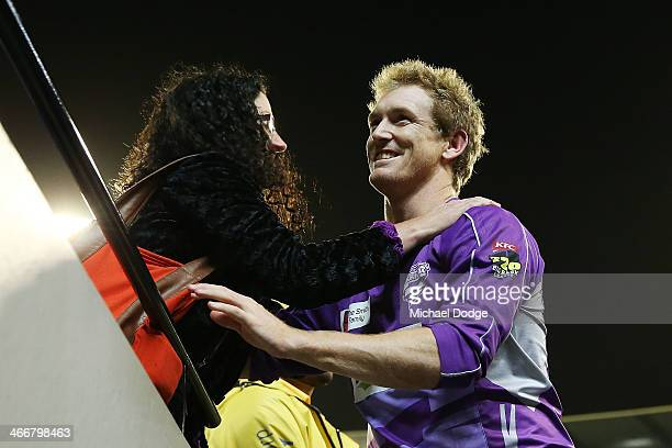 George Bailey of the Hurricanes celebrates their win with a fan during the Big Bash League Semi Final match between the Melbourne Stars and the...