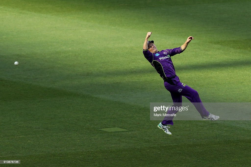 George Bailey of the Hurricanes dives for a catch during the Big Bash League match between the Melbourne Stars and and the Hobart Hurricanes at Melbourne Cricket Ground on January 27, 2018 in Melbourne, Australia.
