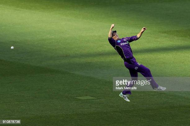 George Bailey of the Hurricanes dives for a catch during the Big Bash League match between the Melbourne Stars and and the Hobart Hurricanes at...