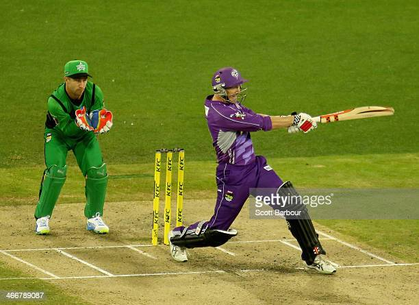 George Bailey of the Hurricanes hits a boundary as Stars wicketkeeper Matthew Wade looks on during the Big Bash League Semi Final match between the...