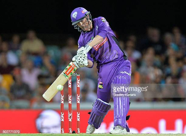 George Bailey of the Hurricanes hits the ball to the boundary for a four during the Big Bash League match between the Brisbane Heat and Hobart...