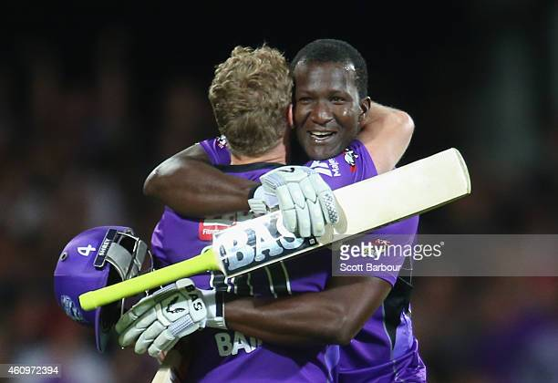 George Bailey of the Hurricanes is congratulated by Darren Sammy after hitting the winning runs during the Big Bash League match between the Hobart...
