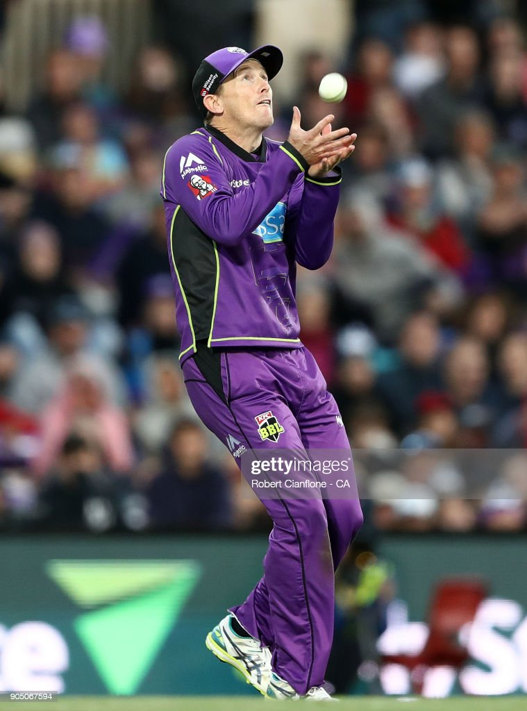 George Bailey of the Hurricanes taks a catch to dismiss Brendon McCullum of the Heat during the Big Bash League match between the Hobart Hurricanes and the Brisbane Heat at Blundstone Arena on January 15, 2018 in Hobart, Australia.
