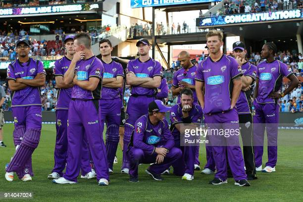 George Bailey of the Hurricanes talks with Dan Christian as the team looks on after being defeated during the Big Bash League Final match between the...