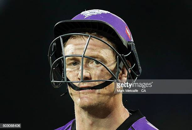 George Bailey of the Hurricanes walks from the field after the end of innings during the Big Bash League match between the Hobart Hurricanes and the...