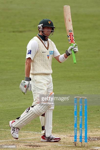 George Bailey of the Tigers celebrates his century during day four of the Sheffield Shield match between the Western Australia Warriors and the...