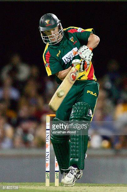 George Bailey of the Tigers hits out during the ING Cup match between the Queensland Bulls and Tasmanian Tigers at the Gabba December 4 2004 in...