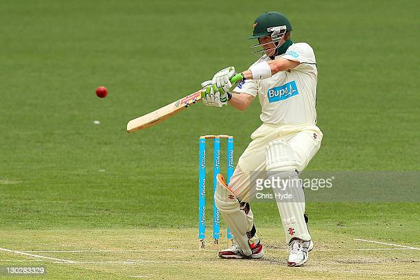 George Bailey of the Tigers hits the ball during day two of the Sheffield Shield match between the Queensland Bulls and the Tasmania Tigers at The...