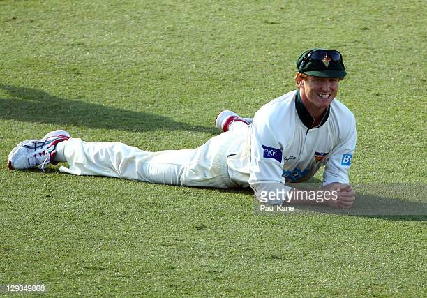 George Bailey of the Tigers looks on as the ball heads to the boundary during day two of the Sheffield Shield match between the Western Australia...