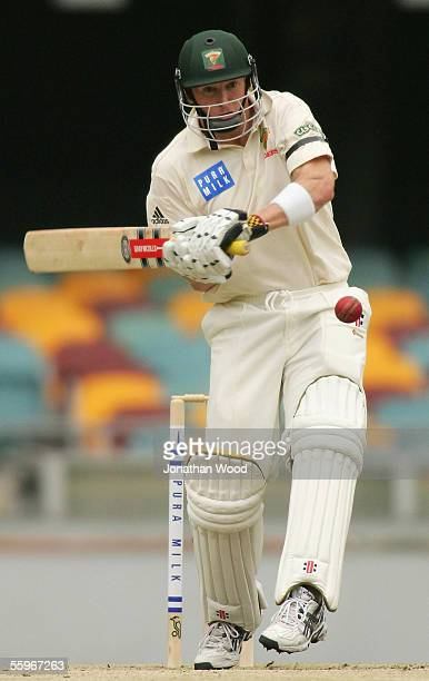 George Bailey of the Tigers prepares to hit out during day four of the Pura Cup match between the Queensland Bulls and Tasmanian Tigers at the Gabba...