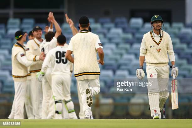 George Bailey of the Tigers walks back to the rooms after being dismissed by Jhye Richardson of Western Australia during day two of the Sheffield...